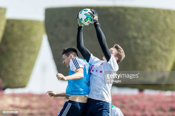 Marco Friedl of Muenchen and Goalkeeper Ron Torben Hoffmann of Muenchen battle for the ball during the FC Bayern Muenchen training camp at Aspire...