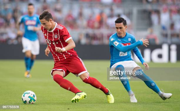 Marco Friedl of Munich passes by Jose Callejon of Naples with the ball during the Audi Cup SSC Naples vs Bayern Munich match at the Allianz Arena in...