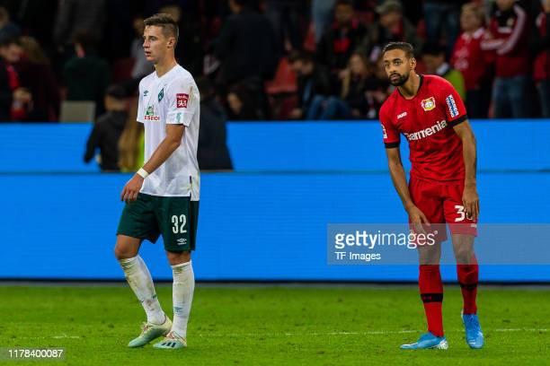 Marco Friedl of SV Werder Bremen and Karim Bellarabi of Bayer 04 Leverkusen looks dejected during the Bundesliga match between Bayer 04 Leverkusen...