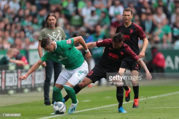 Marco Friedl of SV Werder Bremen and Marco Richter of FC Augsburg battle for the ball during the Bundesliga match between SV Werder Bremen and FC...