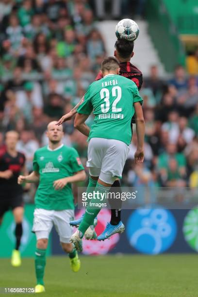 Marco Friedl of SV Werder Bremen and Ruben Vargas of FC Augsburg battle for the ball during the Bundesliga match between SV Werder Bremen and FC...