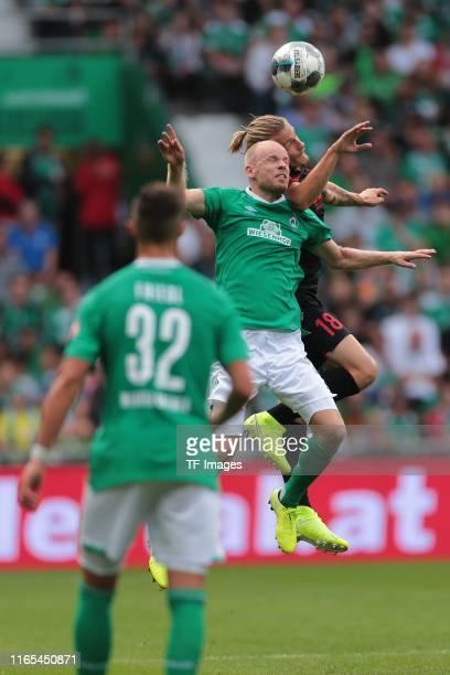 Marco Friedl of SV Werder Bremen Davy Klaassen of SV Werder Bremen and Tin Jedvaj of FC Augsburg battle for the ball during the Bundesliga match...