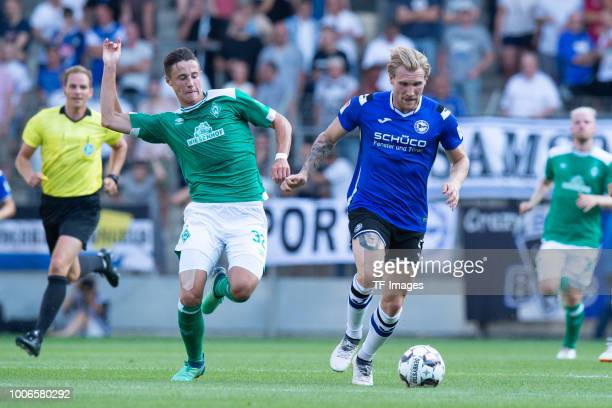 Marco Friedl of Werder Bremen and Andreas Voglsammer of Bielefeld battle for the ball during the Friendly match between Arminia Bielefeld and SV...