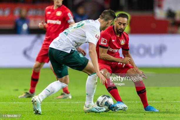 Marco Friedl of Werder Bremen and Karim Bellarabi of Bayer 04 Leverkusen battle for the ball during the Bundesliga match between Bayer 04 Leverkusen...