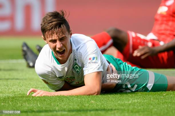 Marco Friedl of Werder Bremen lays on the ground during the Interwetten Cup match between RotWeiss Essen and SV Werder Bremen at Stadion Essen on...