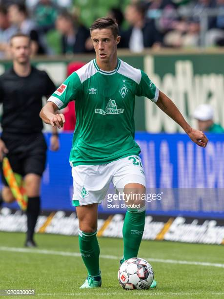 Marco Friedl of Werder Bremen runs with the ball during the Pre Season Friendly Match between Werder Bremen and FC Villareal at Weserstadion on...