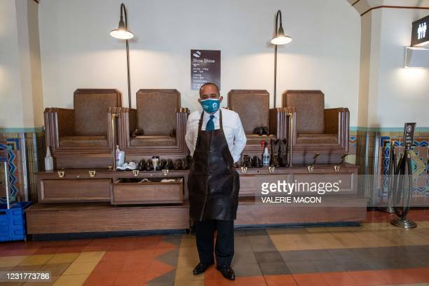 """Marco from the """"Union Station's Shoe Shine and Repair"""" poses in front of his booth, in the Union Station downtown L.A. Where part of the Oscars..."""
