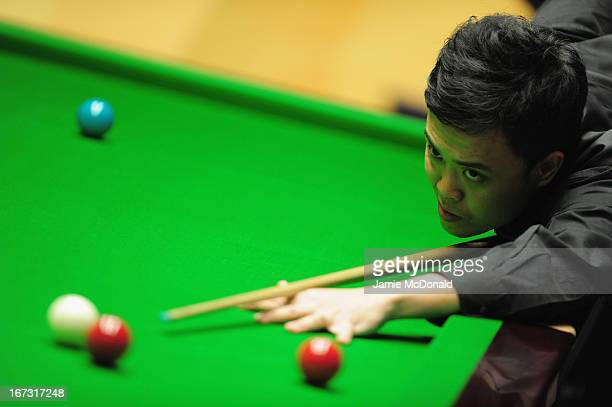 Marco Fu in action during his first round match against Mathew Steven during the Betfair World Snooker Championship at the Crucible Theatre on April...