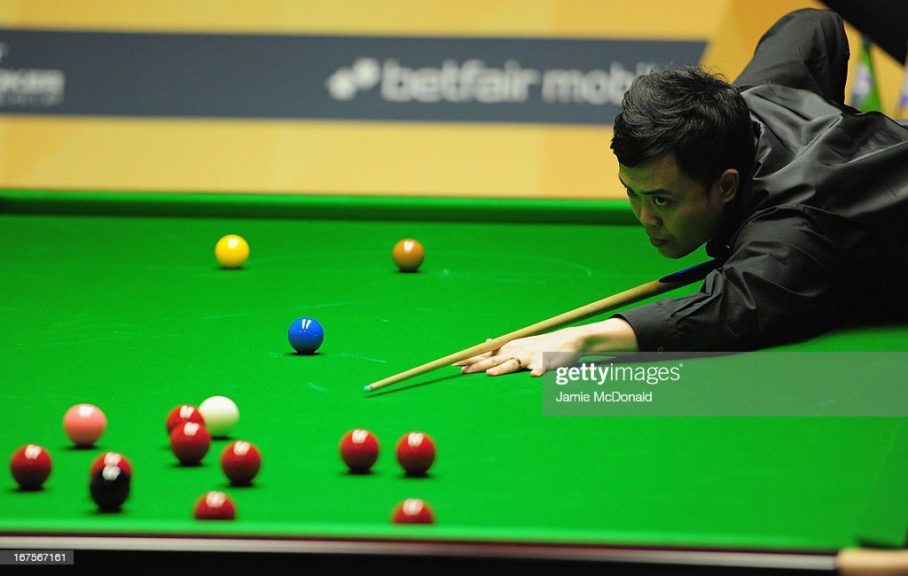 Marco Fu in action during his second round match against Judd Trump during the Betfair World Snooker Championship at the Crucible Theatre on April 26, 2013 in Sheffield, England.