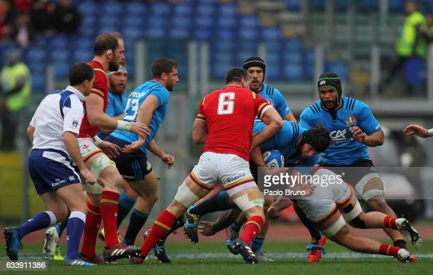 Marco Fuser of Italy is tackled by Sam Warburton of Wales during the RBS Six Nations match between Italy and Wales at Stadio Olimpico on February 5...