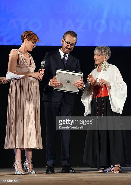 Marco Giallini receives the Nino Manfredi Award from Erminia Ferrari and Anna Foglietta during the Nastri D'Argento Awards Ceremony 2014 on June 28...