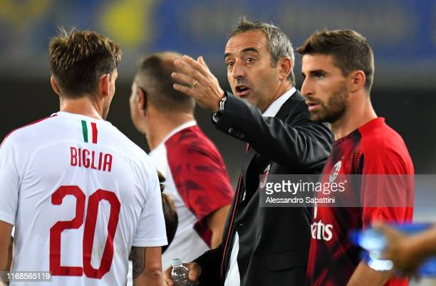 Marco Giampaolo head coach of AC Milan issues instructions to his players during the Serie A match between Hellas Verona and AC Milan at Stadio...