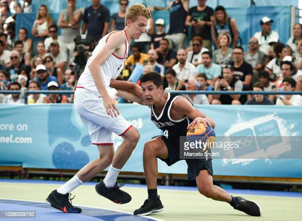 Marco Giordano Gnass of Argentina competes for the ball against Sam Hofman of Belgium Men's Gold Medal Game during day 11 of the Buenos Aires Youth...
