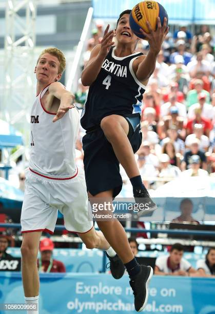 Marco Giordano Gnass of Argentina goes for a dunk against Ferre Vanderhoydonck of Belgium Men's Gold Medal Game during day 11 of the Buenos Aires...