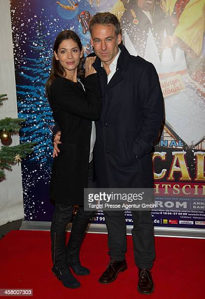 Marco Girnth and his wife Katja Woywood attend the 10th Roncalli Christmas Circus at Tempodrom on December 19 2013 in Berlin Germany