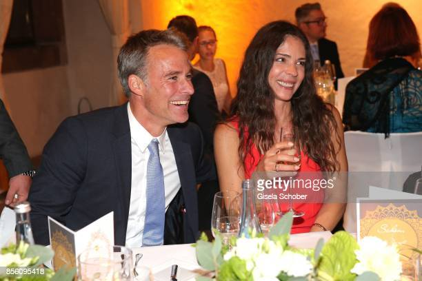 Marco Girnth and his wife Katja Woywood during the church wedding of Erdogan Atalay and Katja Ohneck at Heidelberg Castle on September 30 2017 in...