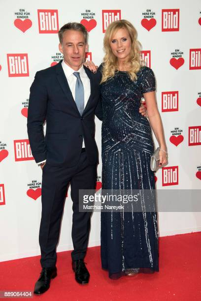 Marco Girnth and Melanie Marschke arrive at the Ein Herz Fuer Kinder Gala at Studio Berlin Adlershof on December 9 2017 in Berlin Germany