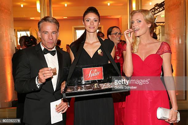 Marco Girnth and Melanie Marschke eat cookies during the Leipzig Opera Ball 'Let's dance Dutch' at alte Oper on September 10 2016 in Leipzig Germany