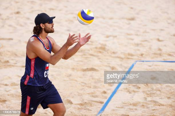 Marco Grimalt of Team Chile prepares to serve against Team Poland during the Men's Preliminary - Pool E beach volleyball on day four of the Tokyo...