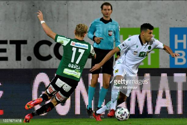 Marco Gruell of Ried and Raffael Behounek of Innsbruck during the 2. Liga match between SV Guntamatic Ried and FC Wacker Innsbruck at josko ARENA on...