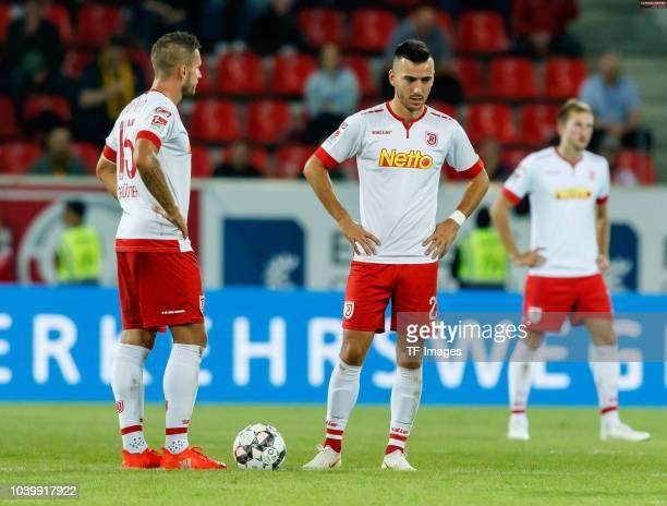 Marco Gruettner of Jahn Regensburg and Sargis Adamyan of Jahn Regensburg look dejected during the Second Bundesliga match between SSV Jahn Regensburg...