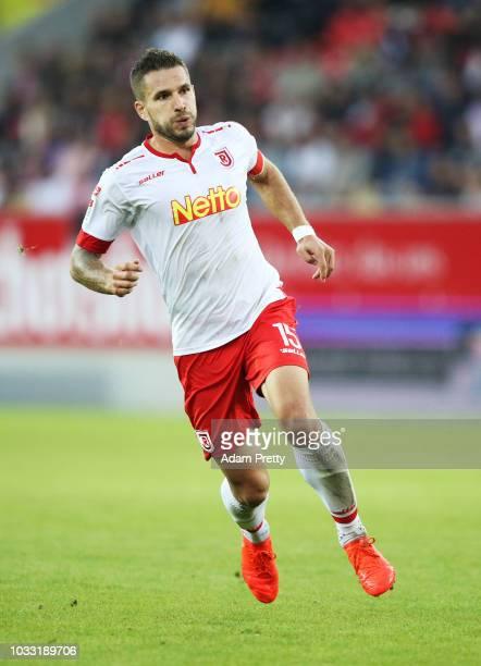 Marco Gruettner of Jahn Regensburg in action during the Second Bundesliga match between SSV Jahn Regensburg and SG Dynamo Dresden at Continental...