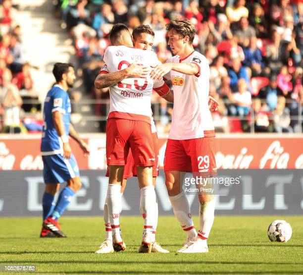 Marco Gruettner of Jahn Regensburg is congratulated by Sargis Adamyan of Jahn Regensburg scoring a goal during the Second Bundesliga match between...