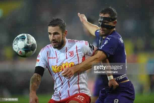Marco Gruettner of Regensburg and Ulrich Taffertshofer of Osnabrück compete for the ball during the Second Bundesliga match between SSV Jahn...