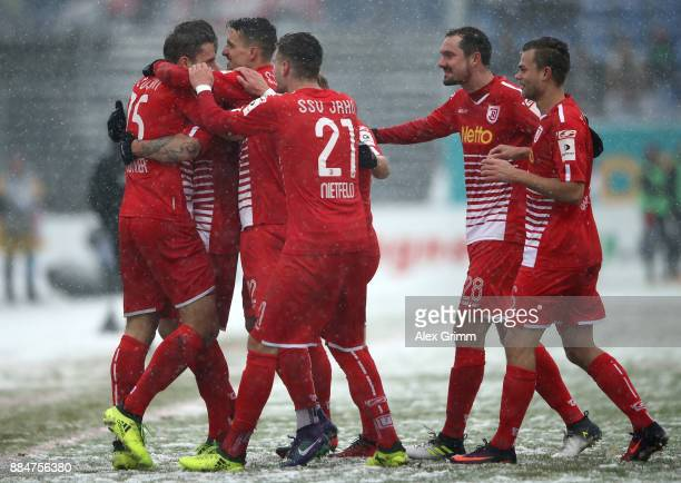Marco Gruettner of Regensburg celebrate with his team mates after he scores the opening goal during the Second Bundesliga match between SV Darmstadt...