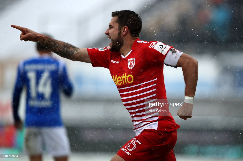 Marco Gruettner of Regensburg celebrates after he scores the opening goal during the Second Bundesliga match between SV Darmstadt 98 and SSV Jahn Regensburg at Jonathan-Heimes-Stadion am Boellenfalltor on December 3, 2017 in Darmstadt, Germany.