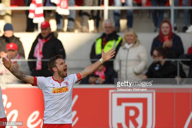 Marco Gruettner of Regensburg celebrates after scoring his team's second goal during the Second Bundesliga match between SSV Jahn Regensburg and...