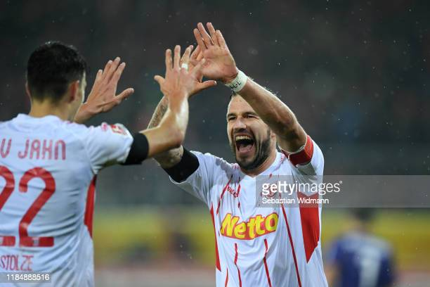 Marco Gruettner of Regensburg celebrates with teammate Sebastian Stolze after scoring his team's second gaol during the Second Bundesliga match...