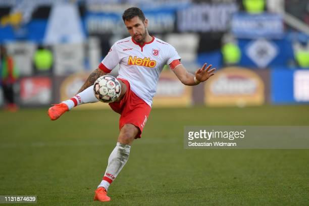 Marco Gruettner of Regensburg plays the ball during the Second Bundesliga match between SSV Jahn Regensburg and Hamburger SV at Continental Arena on...