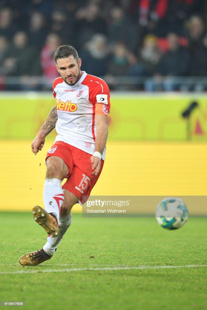 Marco Gruettner of Regensburg shoots the ball during the Second Bundesliga match between SSV Jahn Regensburg and FC Ingolstadt 04 at Continental Arena on January 26, 2018 in Regensburg, Germany.