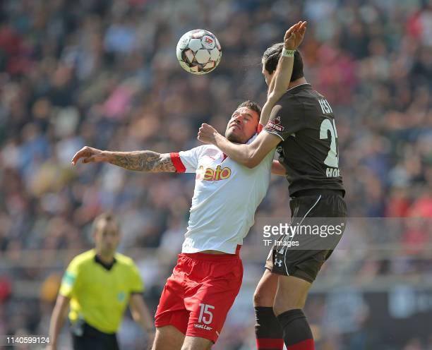 Marco Gruettner of SSV Jahn Regensburg and Justin Hoogma of FC St. Pauli battle for the ball during the Second Bundesliga match between FC St. Pauli...