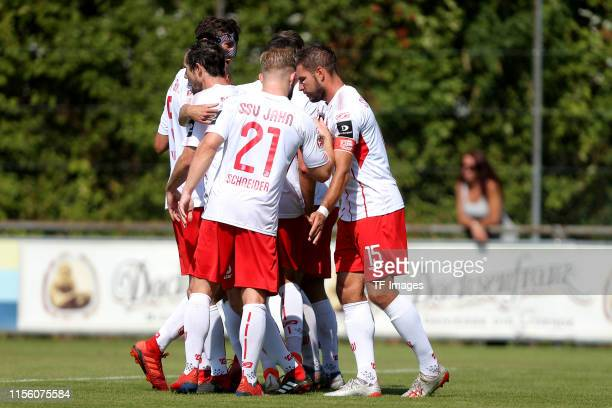 Marco Gruettner of SSV Jahn Regensburg celebrates after scoring his team's second goal with team mates during the pre-season friendly match between...