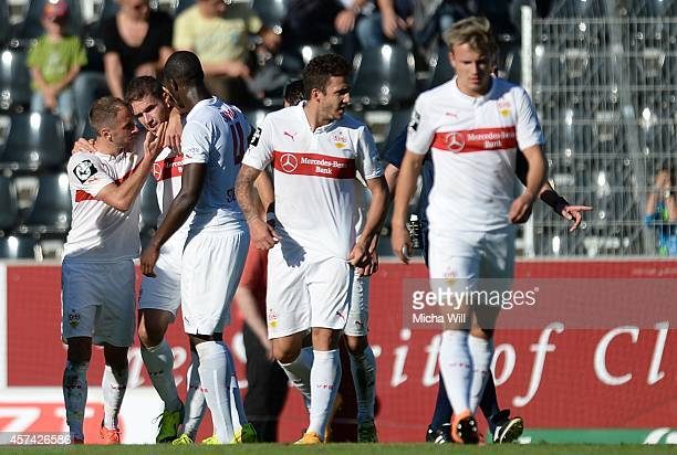 Marco Gruettner of VfB Stuttgart celebrates with team-mates after scoring his team's fifth goal during the Third League match between VfB Stuttgart...