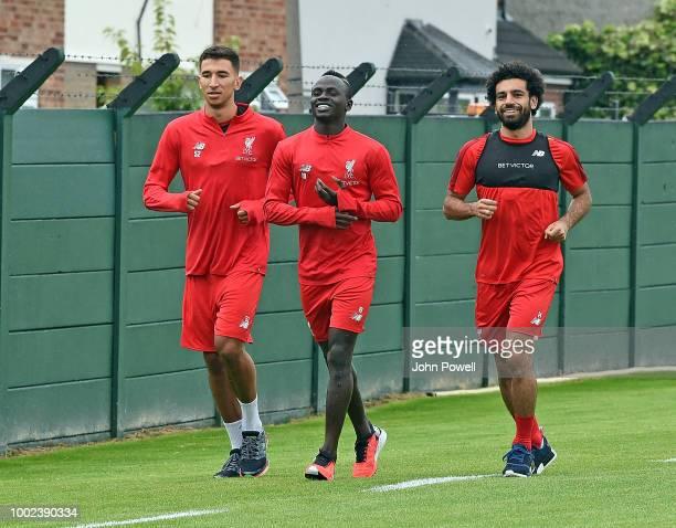 Marco Grujic with Mohamed Salah and Sadio Mane of Liverpool having tests on their first day back at Melwood Training Ground on July 20 2018 in...