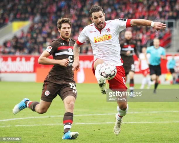 Marco Gruttner of Jahn Regensburg controls the ball in front of Daniel Buballa of St Pauli during the Second Bundesliga match between SSV Jahn...