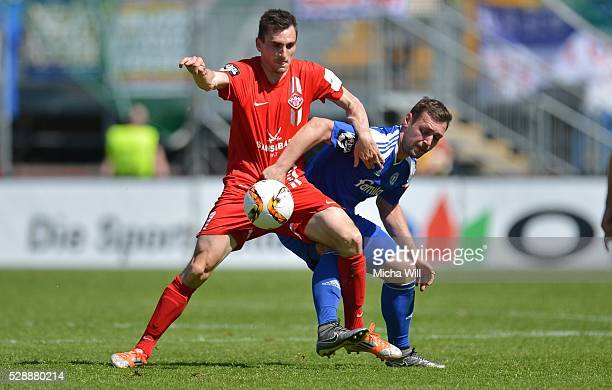 Marco Haller of Wuerzburg and Maik Kegel of Kiel tussle for the ball during the Third League match between Wuerzburger Kickers and Holstein Kiel at...