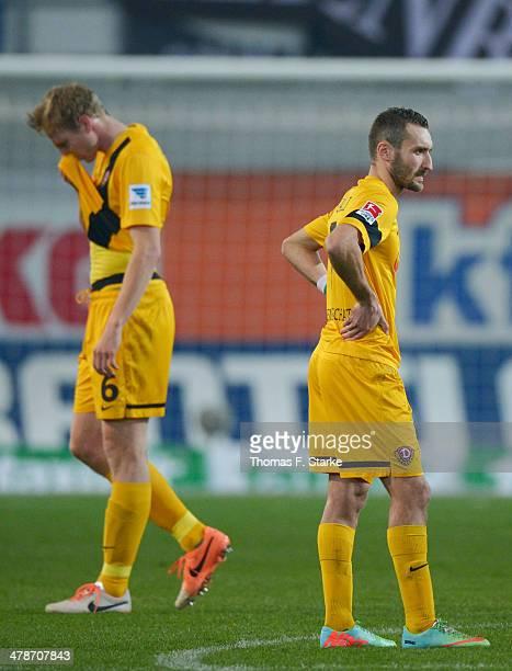 Marco Hartmann and Idir Ouali of Dresden look dejected after loosing the Second Bundesliga match between SC Paderborn and Dynamo Dresden at Benteler...