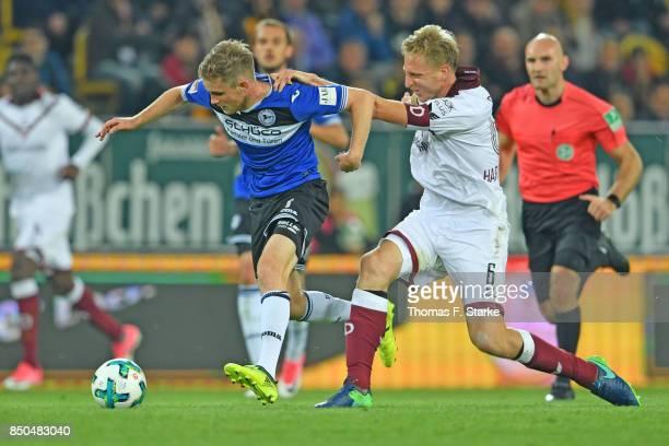 Marco Hartmann of Dresden tackles Patrick Weihrauch of Bielefeld during the Second Bundesliga match between SG Dynamo Dresden and DSC Arminia...