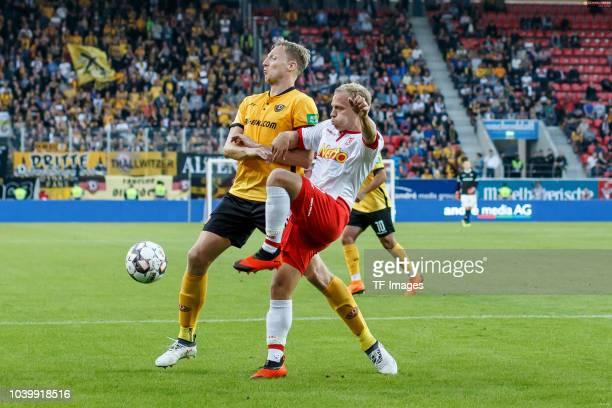 Marco Hartmann of Dynamo Dresden and Alexander Nandzik of Jahn Regensburg battle for the ball during the Second Bundesliga match between SSV Jahn...