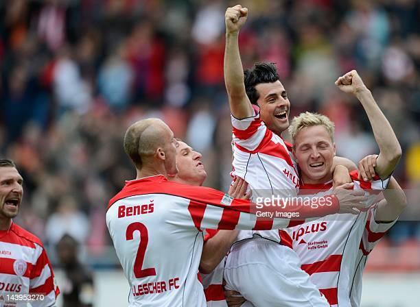 Marco Hartmann Rebelo Teixera andJan Benes of Halle celebrate after the 10 goal during the Regionalliga Nord match between Hallescher FC an FC St...
