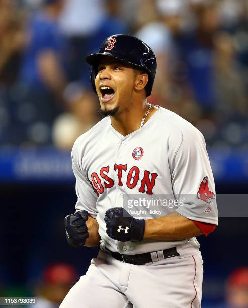 Marco Hernandez of the Boston Red Sox celebrates hitting a solo home run in the ninth inning during a MLB game against the Toronto Blue Jays at...