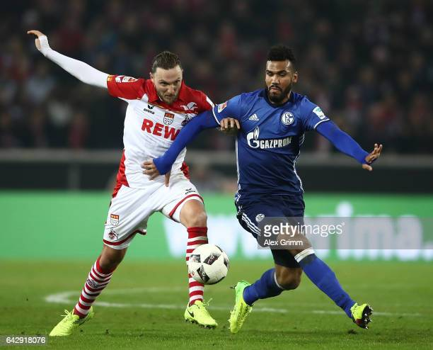 Marco Hger of Koeln is challenged by Maxim ChoupoMoting of Schalke during the Bundesliga match between 1 FC Koeln and FC Schalke 04 at...