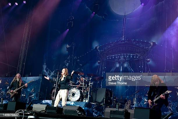 Marco Hietala Anette Olzon and Emppu Vuorinen of Nightwish perform on stage during Download Festival at Donington Park on June 8 2012 in Castle...