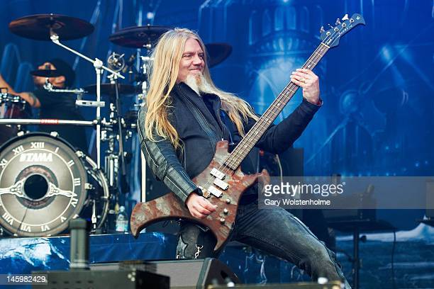 Marco Hietala of Nightwish performs on stage during Download Festival at Donington Park on June 8, 2012 in Castle Donington, United Kingdom.