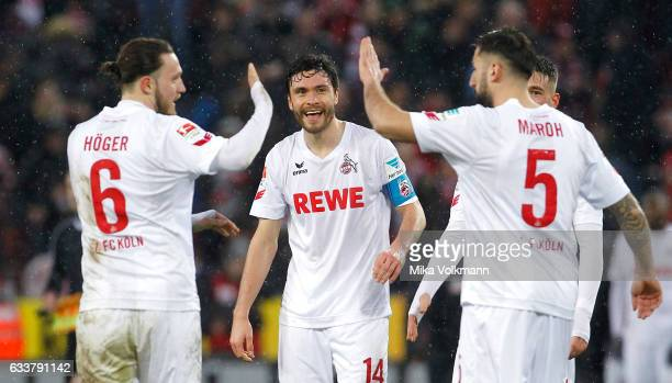 Marco Hoeger of Cologne Jonas Hector of Cologne and Dominic Maroh of Cologne celebrate the victory 10 during the Bundesliga match between 1 FC Koeln...
