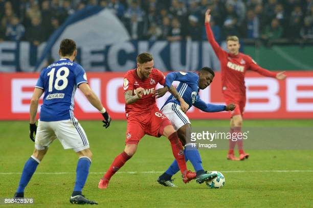 Marco Hoeger of Koeln and Breel Embolo of Schalke battle for the ball during the Bundesliga match between FC Schalke 04 and 1 FC Koeln at...